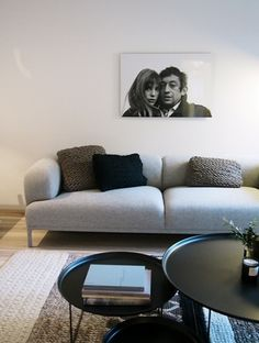 knit + grey sofa + portraits
