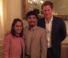 Manny Pacquiao (C) poses for a picture with Prince Harry (R) and his wife Jinkee (L).  Manny Pacquiao was invited to dine in to Buckingham Palace by Prince Harry in Jan. 2015
