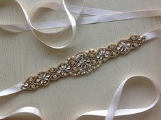 Check out this item in my Etsy shop https://www.etsy.com/uk/listing/582332416/anabel-gold-ivory-satin-sparkly-beaded