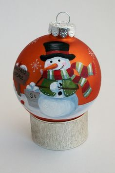 my step mom always gave us each a hand painted ornament every