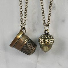Peter Pan & Wendy Kiss Thimble and Acorn Necklace Set - for each of us to wear at the wedding :) I wear the acorn, he wears the thimble...