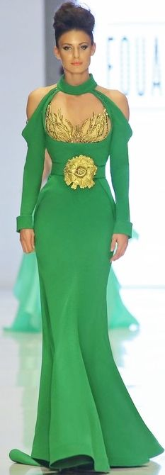 I'd really love this if it were more of a forest green and we could lose tha ridiculous gold embellishment on her tummy.    This is Fouad Sarkis Haute Couture