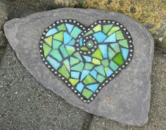 Heart     I've started doing mosaics on rocks. Like the flag I displayed in my last post. I go to the beach and pick up a bunch of rocks ...