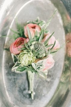 spring boutonnieres - photo by Elizabeth Fogarty http://ruffledblog.com/romantic-vintage-inspired-wedding-in-maryland