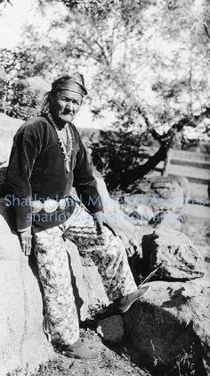 Navajo man in traditional dress, S.L., C.1920