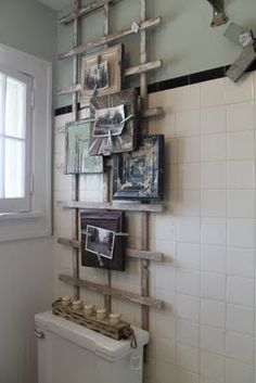 - photo holder made from an old garden trellis, ceiling tin and magnet clothespins -