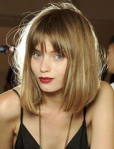 Bangs & bob, red lipstick & mouse-blonde hair