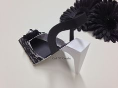 The shoe favour created in white with black lace and a handmade fabric rose! ❤ www.cutncreate.com http://facebook.com/CutnCreate