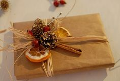 rustic packaging...craft paper...dried citrus...pine cone...cinnamon...rafia
