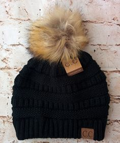 A little twist on the popular CC beanie hats - a faux fur pom pom on top! Available in 13 fabulous colors - the perfect winter accessory! 100% Acrylic, one size fits most. Also available without the f