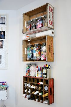 wooden crate shelving; Erikka did something similar with old wooden drawers.....they look really nice on the walls