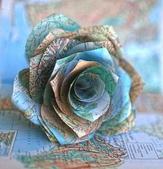 Recycled DIY paper flowers perfect for Valentine's Day. Make a bouquet from scrap paper Map Crafts, Book Crafts, Kids Crafts, Craft Projects, Arts And Crafts, Craft Ideas, Crafts With Maps, Handmade Flowers, Diy Flowers