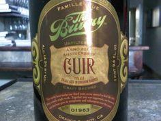 Cerveja The Bruery Cuir, estilo Old Ale, produzida por The Bruery, Estados Unidos. 14.5% ABV de álcool.