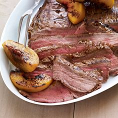 Massaging this sweet and spicy teriyaki marinade into flank steak for just five minutes is all you need to get maximum flavor. Grill summer peaches along with the meat and serve as a sweet, juicy accompaniment.