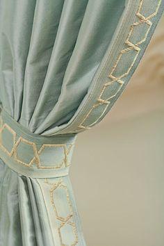 Silk drapery panels w/ gold chain link trim .