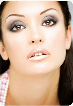 Glam Smokey Eyes: Blue/Grey/Brown/Nude/White Eyeshadow, Lined Upper and Smudged Lower Lids, Extension Mascara, Defined Brows, Light Blush, Nude Shimmer Lipstick and Gloss.