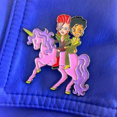 "Two unforgettable legends, riding together, on a beautiful unicorn ❤️ Limited Edition + Illustrated for Laser Kitten by Iscreamcolour Our largest pin yet at 2""."