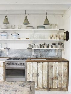 reclaimed wood cupboards - could do doors with pull out drawers rather than all drawer fronts