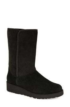 Free shipping and returns on UGG® Australia 'Amie - Classic Slim™' Water Resistant Short Boot (Women) at Nordstrom.com. Water-resistant suede upgradesa classic short boot, updated with a sleeker profile that streamlines the heritage style. Cozy genuineshearlinglining andanUGGpure™ footbed help to keep you warm when winter weather strikes. UGGpure is a textile made entirely from wool but shaped to feel and wear like genuine shearling.