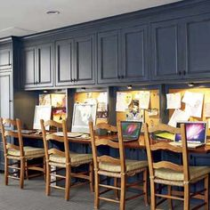 This basement homework station for a family with four kids was inspired by library carrels. The upper cabinets hold school and art supplies, and also hide ductwork. | Photo: Tria Giovan | thisoldhouse.com