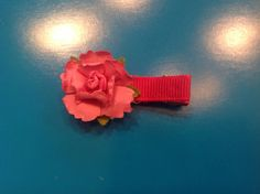 Cute pink flower hair clip in bright pink color. Ribbon covered clip with craft paper flower. Perfect for children! Includes non slip lining inside clip. Please inquire about other ribbon or flower colors.