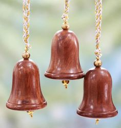 Artisan Dinesh transforms seesham wood into a festive set of three ringing #bells.