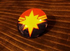 Captain Marvel Glass Pin by TheEsotericRainbow on Etsy, $2.00