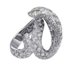 Cartier Snake-motif ring. Platinum, brown diamond eyes, diamond