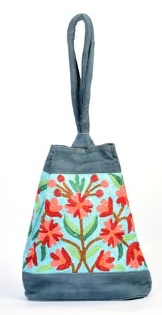 Handmade Antique Design Grey Color Leather Embroidery Big Pouch madeup of Velvet material all over embroidery with lomg handels  for womens and girls to carry casually  all things in it spacious and suits on every dressing style.Safe magnet closer button