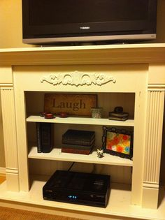 Refurbish A Fireplace Into A TV Stand Cabinet By Adding Shelves And A Bead  Board Back