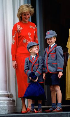 A photograph of Princess Diana with Prince Harry and Prince William as children wearing school uniforms