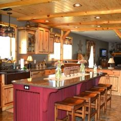 Rustic but elegant kitchen with warm knotty pine cabinets featuring an antique glaze and burgundy accents. Come take a tour of the rest!