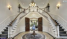 A beautiful butterfly staircase in the grand foyer of this georgian mansion