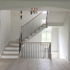 Simple Stair with iron balusters, oak rails and v-groove backs in front of two story window. Black iron and wood stair railing. Wooden Staircase Design, Staircase Railings, Wooden Stairs, Stairways, Staircase Outdoor, Spiral Staircases, Painted Stairs, Banisters, Oak Handrail