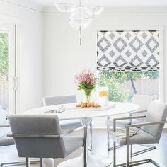 Alyssa Rosenheck: Oval Marble Saarinen Dining Table with Gray Dining Chairs