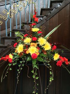Autumn flower pedestal arrangement at St Phillips cathedral, Birmingham. Arranged by flower buds at Eden florists. Www.edenflorists.weebly.com