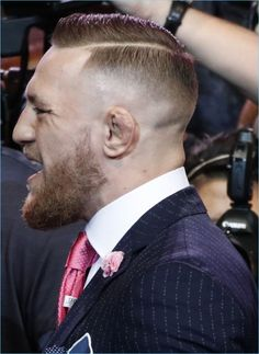 "Making quite the style statement, Conor McGregor's pinstripe suit reads ""F**k You"""