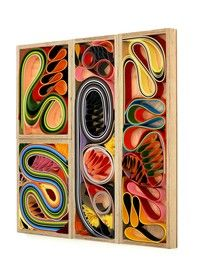 abstract paper quilling in a box frame.
