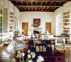 """In a June 1991 article on her home in Southern California, Rose Tarlow said, """"I was trying to prove to myself that you can create an ageless house."""" Decades later, the living room stands the test of time, with its signature design elements, including ceiling crossbeams from an 11th-century English church, 18th-century French doors, and floors of 17th-century oak."""