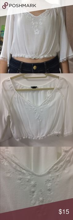 Forever 21 Loose Crop Top Loose white crop top with embellishments and lace along hemline and arms. Forever 21 Tops Crop Tops