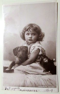 Vintage Dachshund RPPC Postcard; Very Pretty Child Holding her Best Friend Dog and Her Doll by PennysPostcards on Etsy https://www.etsy.com/listing/215659232/vintage-dachshund-rppc-postcard-very