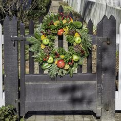 Even the garden gates are decorated at Christmas in Colonial Williamsburg, Virginia