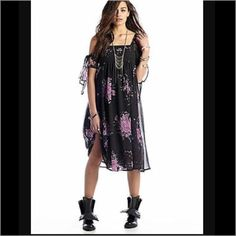 NWT Free People Floral Shift Dress Black with floral, cut out Strappy shoulders. This dress is way cooler in person. No trades, discount with bundle. Offers welcome. Free People Dresses