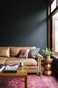 The navy wall intensifies the space, with the couch sinking into the room. Haymes 'Lights off' is a simple yet striking colour which works as the perfect backdrop. Read about the transformation of Kirsten's home here.