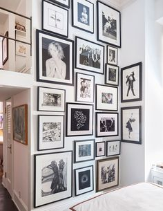 The wall opposite the bed features photographs by Robert Mapplethorpe (whom Donaldson used to work for), Todd Eberle, Koto Bolofo, Peter Beard (who used to live in this apartment), Scavullo, Kurt Markus, Elisabeth Sunday, and two Robert Longo gravures on the right.