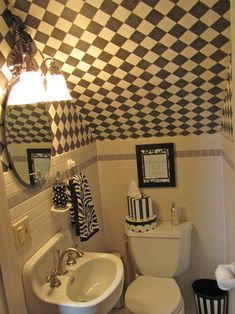 Cute idea for small under stairs bathroom, not that pattern though. I would get so dizzy