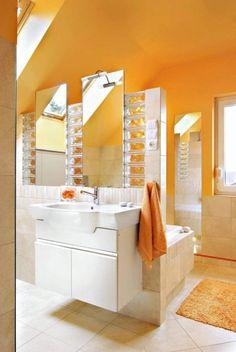 Aranżacje wnętrz. Strefa umywalkowa. Umywalkę od części kąpielowej oddziela lekko wyglądająca ścianka z luster i luksferów.