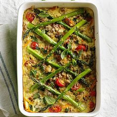 Farro, Cherry Tomato, and Asparagus Casserole Cherry tomatoes nestled between cheesy layers in this vegetable casserole add fresh summer flavor to every bite. Dress it up with fork-tender asparagus, basil, and a pinch of bread crumbs. Asparagus Casserole, Vegetable Casserole, Asparagus Recipe, Vegetarian Recipes, Cooking Recipes, Healthy Recipes, Pork Recipes, Delicious Recipes, Recipies