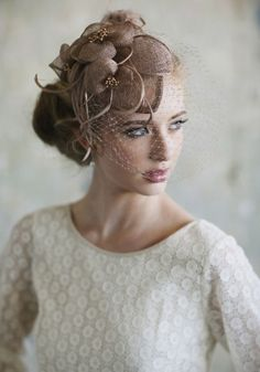 Love the fascinator, and the whole image really. Her make-up is flawless and dress is divine (well, the top bit that I can see is). STUNNING!