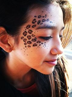 leopard spot face paint by Tess